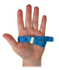 man's hand with tape measure wrapped around