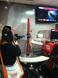 Arc-Zone's Joanie Butler virtual welding on the Lincoln Electric VRTEX at FABTECH 2012