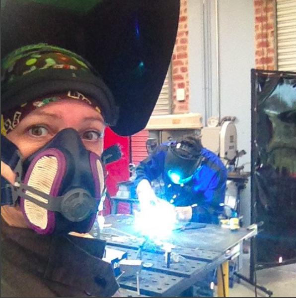 Joanie Butler welding scrap metal into art at Arc-Zone.com