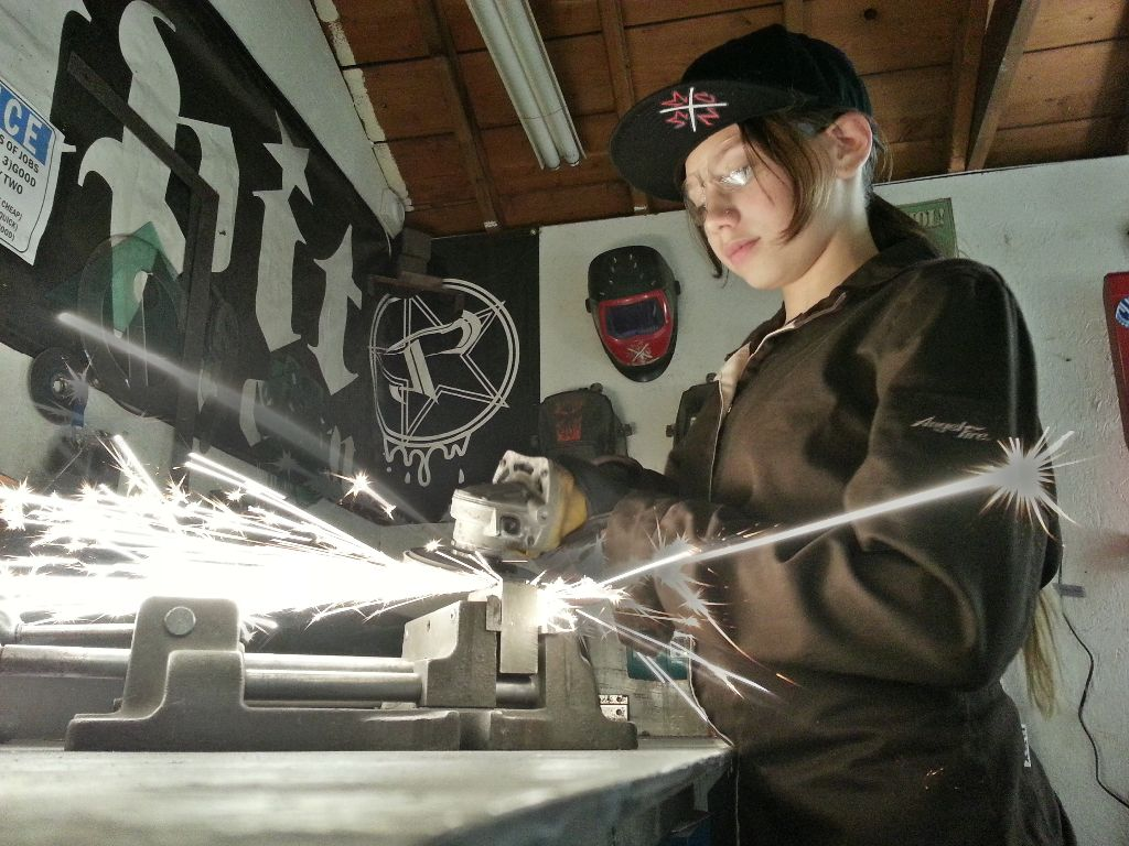Desiree Velez, welding up a storm in her AngelFire welding jacket