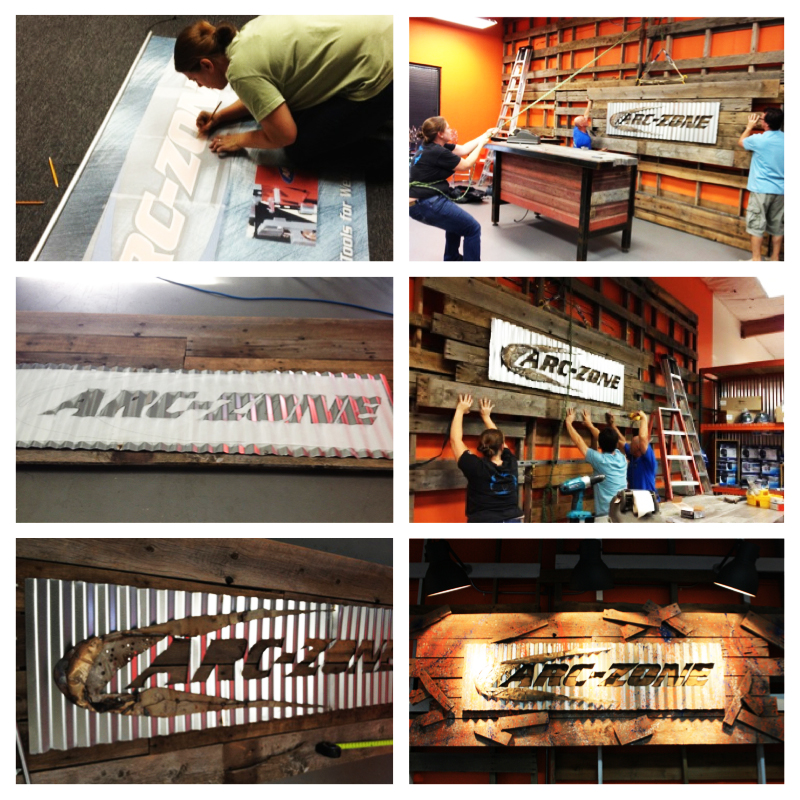 Joanie Butler working on Arc-Zone's Ultimate Showroom sign